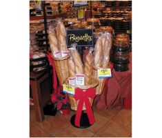 Basket stand with three willow baskets filled with baguettes in bakery