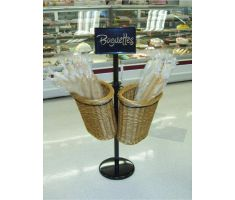 Double Willow Basket Stand filled with baguettes in front of bakery case