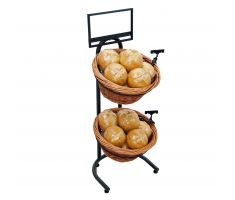 Willow basket floor display holding vegetables with sign clips and sign frame