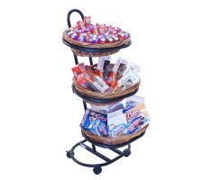 Three-tier oval willow basket filled with milk boxes, donuts, and snacks