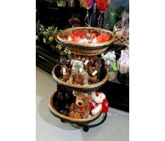 Three Tiered Oval Willow Basket Display filled with Stuffed animals in front of floral.