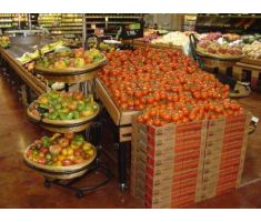 Three-tier large oval basket display filled with fruit next to tomatoes
