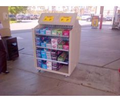 tons of shelving space for soda in the outdoor mobile cart
