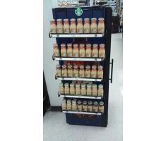 Magnetic display holding onto aisle and holding coffee products on its many shelves.