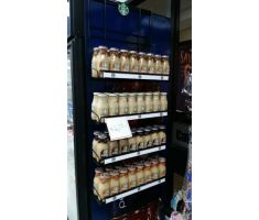 Another magnetic shelf system holding bottled coffee
