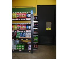 Large display with shelving holding soda. This is the side view to show that it is a one sided attachment.