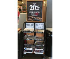 Metal display holding newspapers with large wooden sign frame advertising sale on Washington wines. Display comes with casters and 10 small adjustable wire trays/shelves along two vertical axis.