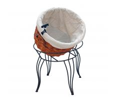 tilted willow basket display with cloth liner and sign clip