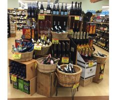 Willow basket display fitting in with wine aisle