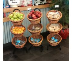Willow basket displays with various products ranging from produce to snacks