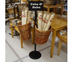 Double Willow Basket Stand in bakery, filled with baguettes