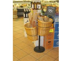Double willow basket stand next to wine an deli