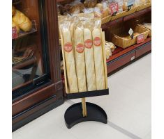 Wooden floor display holding baguettes. Features a single stand with a slanted wooden half tube for displaying baguettes vertically
