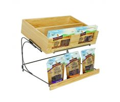 Two tier display with a wood upper shelf, upper shelf holding boxes of dog treats, lower area holding bags of dog treats.