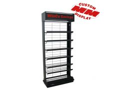 attachable shelving or floor stand with 7 adjustable wire shelves. Display is in black with top mounted area for print graphics. Shelving facing one direction with back of display just slat grid to allow for hanging on aisle.
