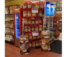 2-tier basket display filled with bagged snacks in front of chip display