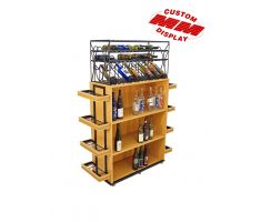 Wooden wine bottle display with shelving and wire wine holder on top. Wooden display has 360 degree shelving, with 3 large shelves on longer sides and 4 smaller shelves on shorter sides. Top wine holder is all wire, ornate, and has a ton of single bottle slots.