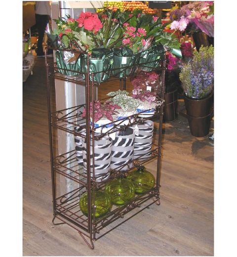 Ornate fold up display in use, holding floral