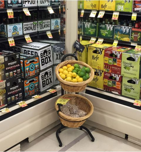 Willow basket display in corner of aisle with produce