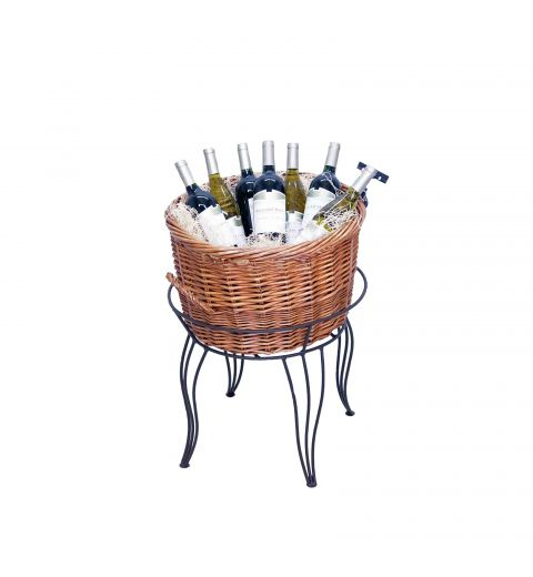 Large willow basket filled with assorted wine bottles in wire stand