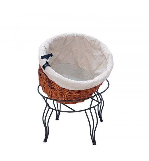 Medium willow basket with fabric liner sitting in stand at an angle