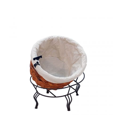 Small Willow Basket with white fabric liner sitting at an angle in wire stand