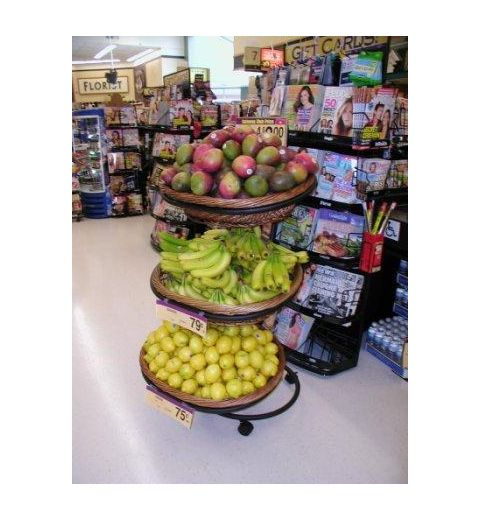 Willow basket display with bananas, lemons, and assortment of fruits